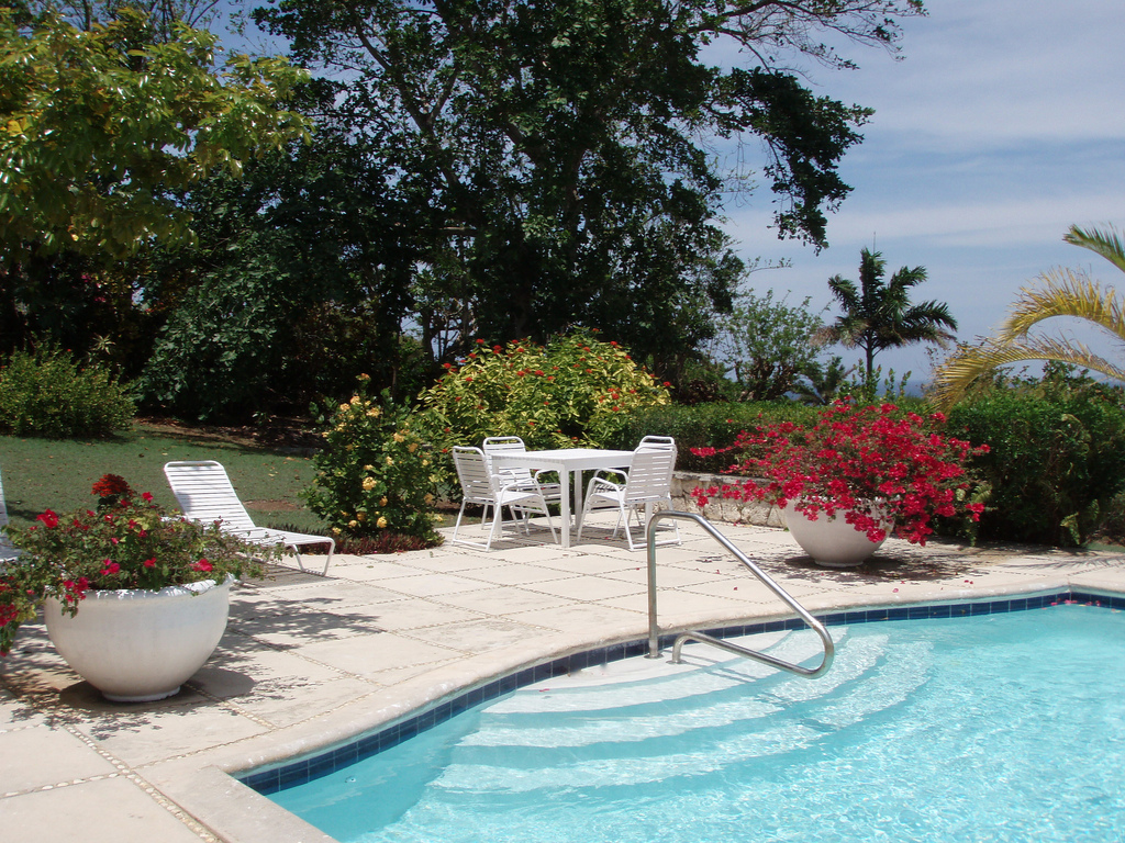 Its large sun-drenched  private pool is great for swimming laps and also great for toddlers at its wide shallow end with railing.