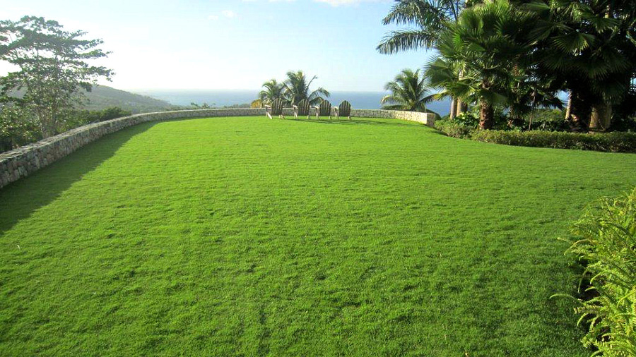 ... 5 acres of perfectly landscaped property include vast, velvet lawns to the delight of energetic youngsters.