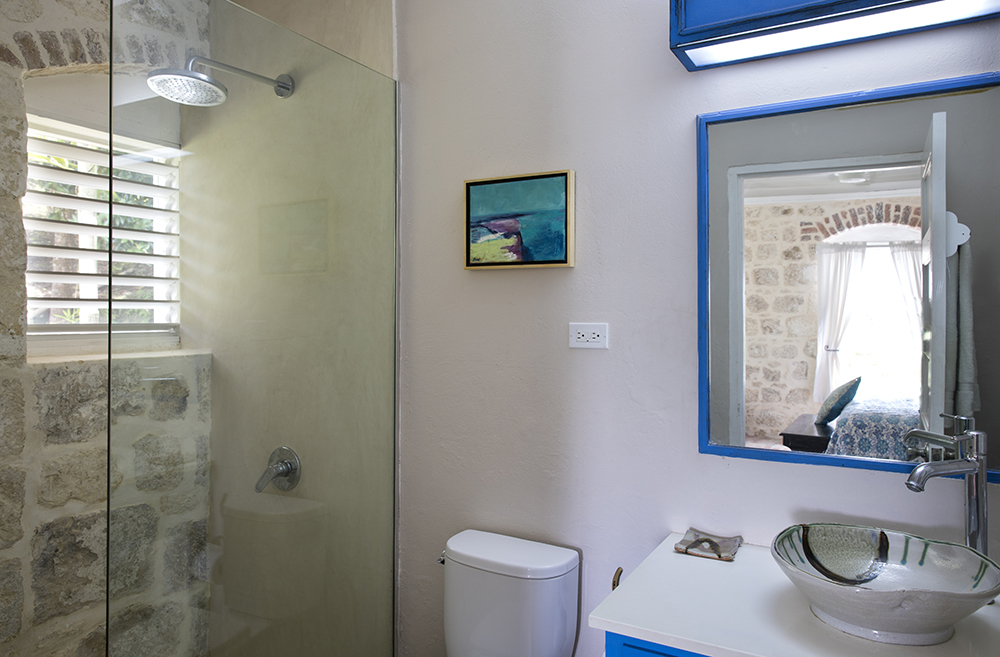 ... and an en-suite shower room. This bedroom also connects through a hallway to Bedroom 4.