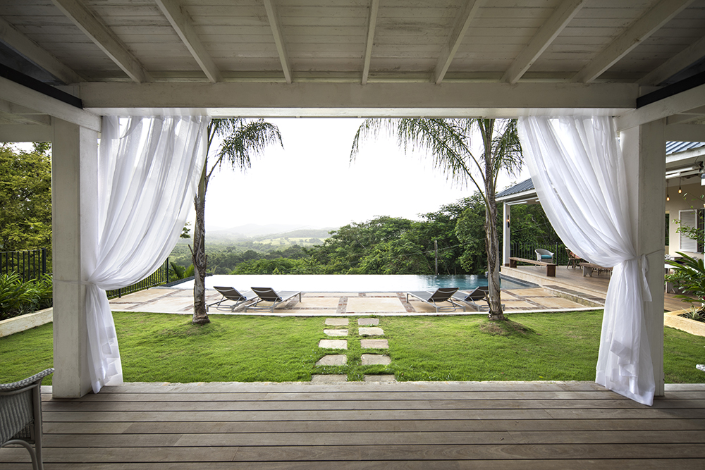 The terrace on the ground floor leads out onto a grass area and the pool deck.