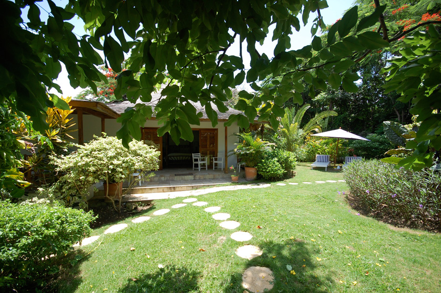 THE COTTAGE At the end of a short walk of stepping stones is the newer two-bedroom cottage.