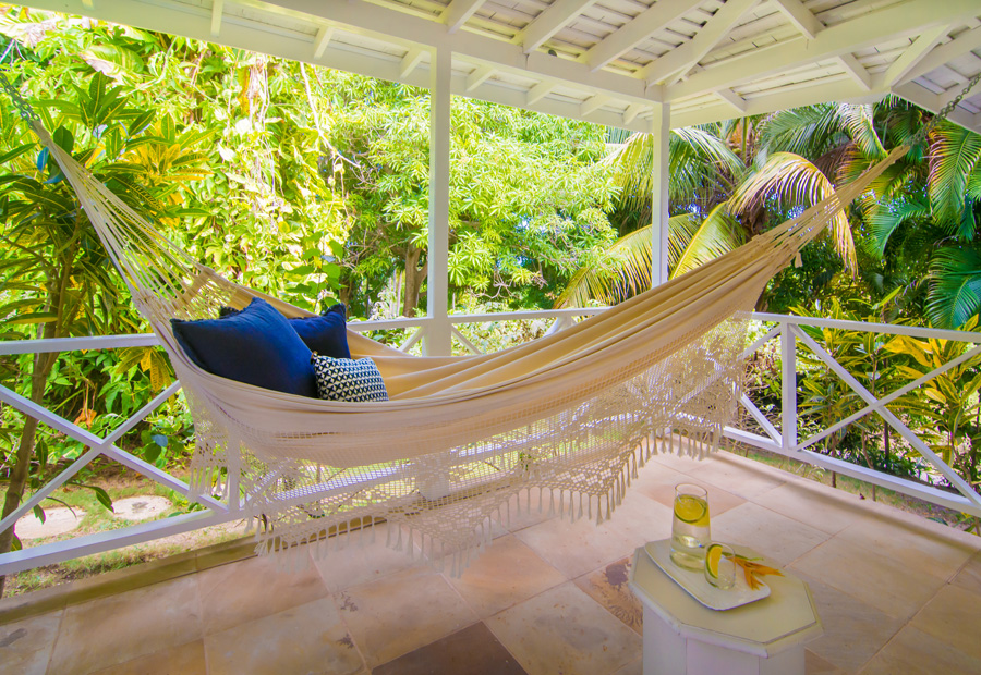 Both Cottage bedrooms open to a quiet porch that feels like a private tree house.