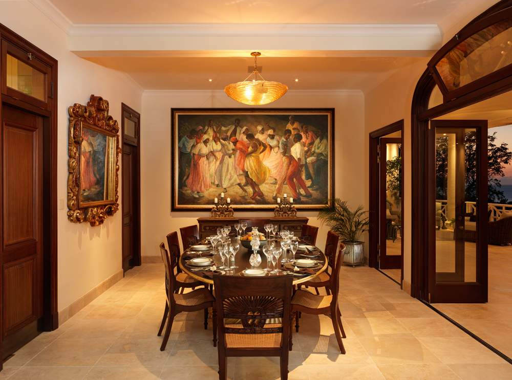 ... and indoor dining room adorned by fine art ...