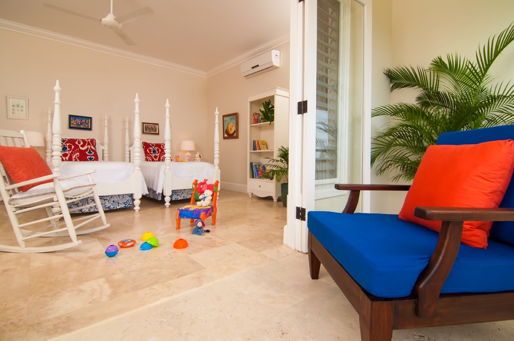 The children's rooms adjacent to each Master Bedroom are twin-bedded and full of books and games, teddy bears and donkeys.