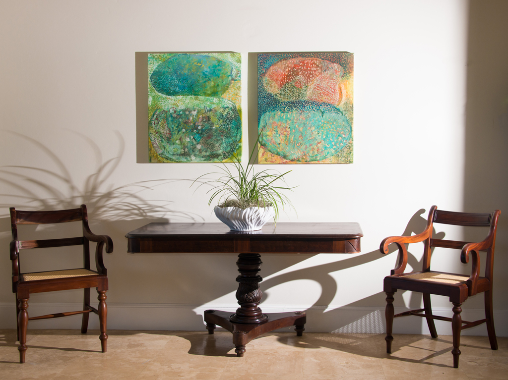 Dining can also be in the indoor dining room, one of the many spaces in Windward that feature this homes marvelous original art.