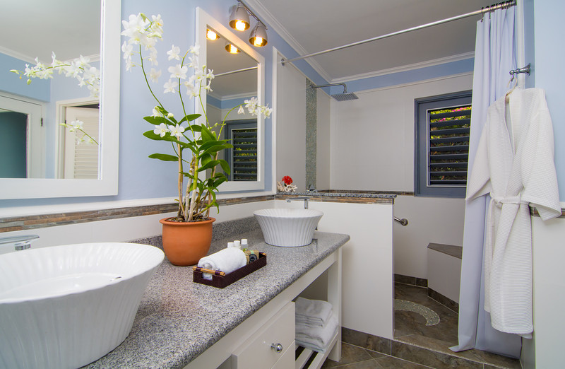 Its en-suite bathroom features a double vanity and walk-in rainfall shower.