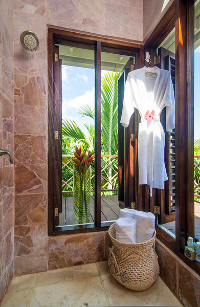 Its en-suite bathroom has a pink marble shower and long view of the Caribbean Sea. Excellent shower for watching sunsets.