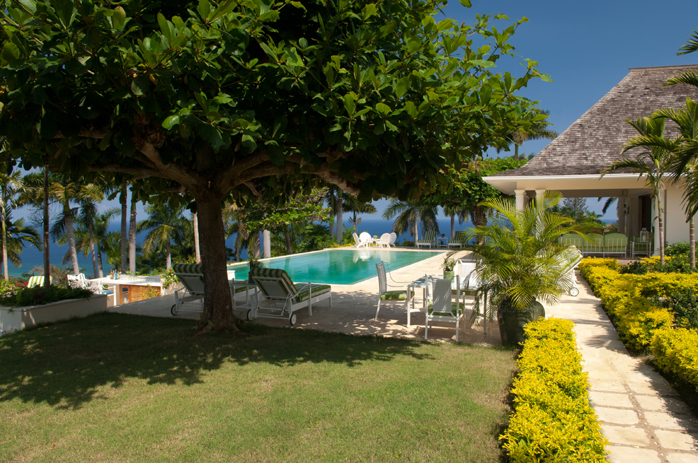 Thoughtfully provided under the almond tree are shaded sitting areas.