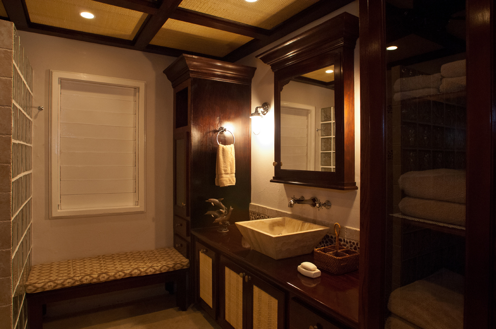 Its his 'n' hers bathroom is handsome in rich mahogany, glass block and woven bamboo.