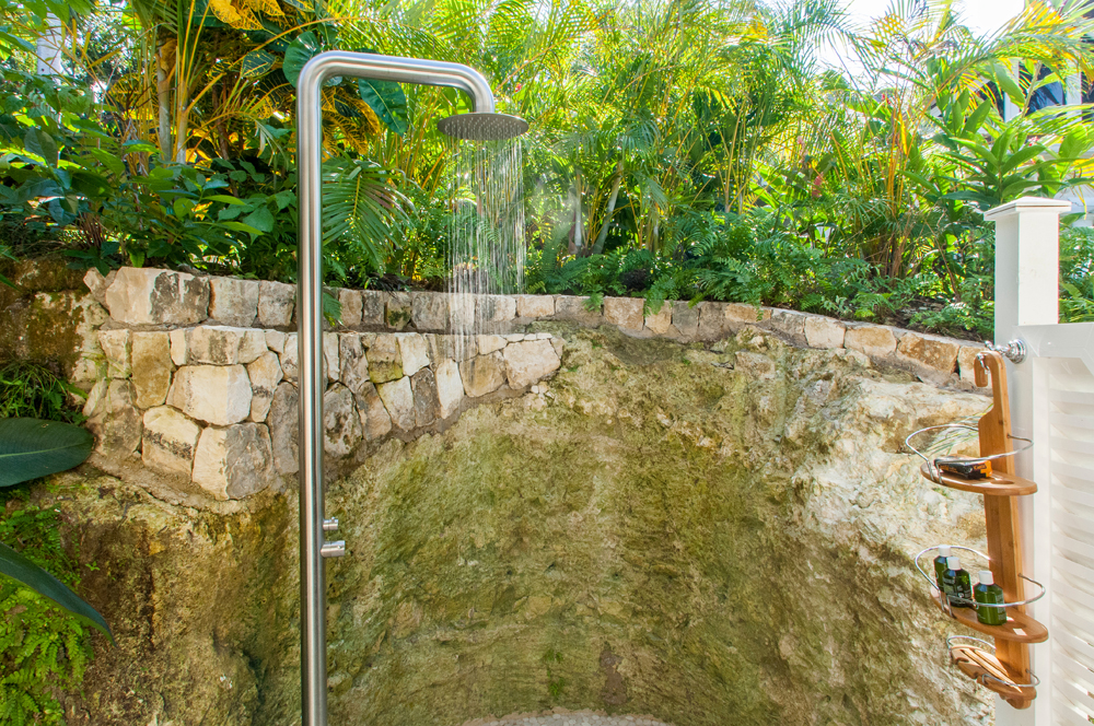 ... and nearby its own outdoor shower too, carved from local coral rock.