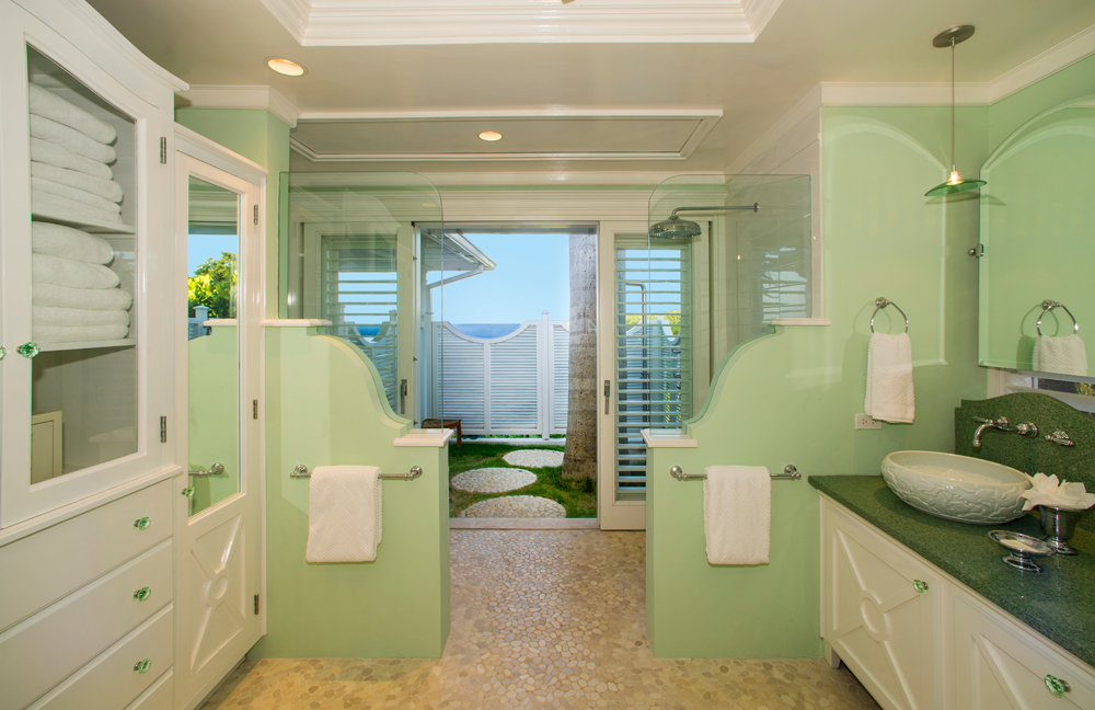 Its chic bathroom opens through an indoor shower ...