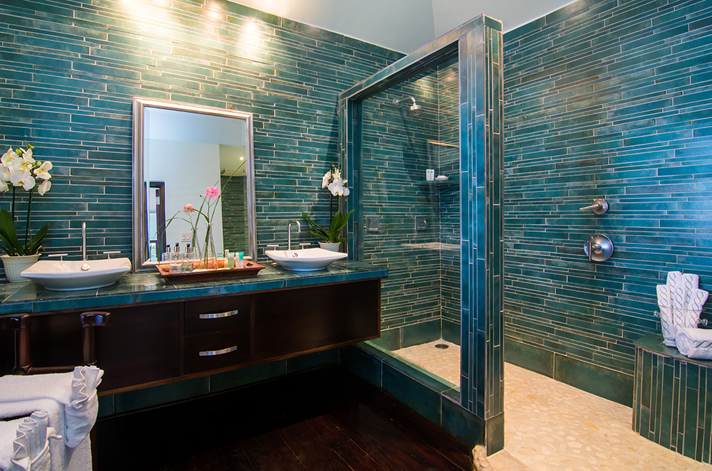 Of special note are this home's stylish bathrooms, featuring custom lighting, Kohler fixtures and artistically-designed tiled showers.