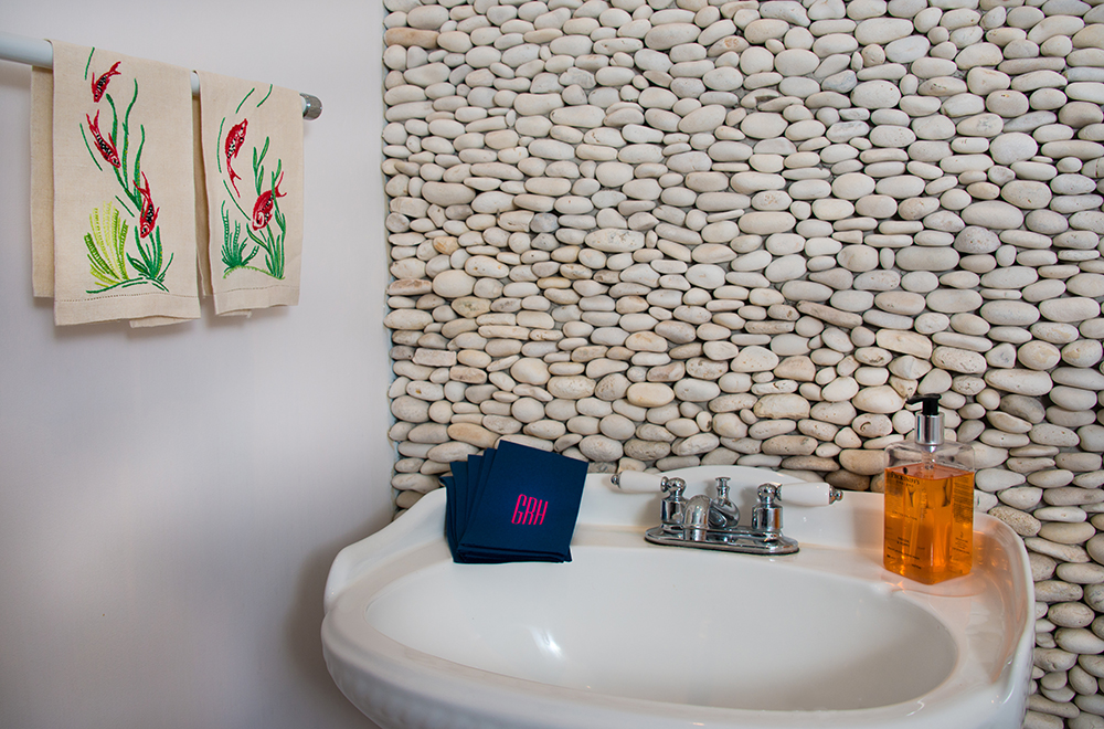 The Feature wall of handpicked stones in the ground floor powder room.