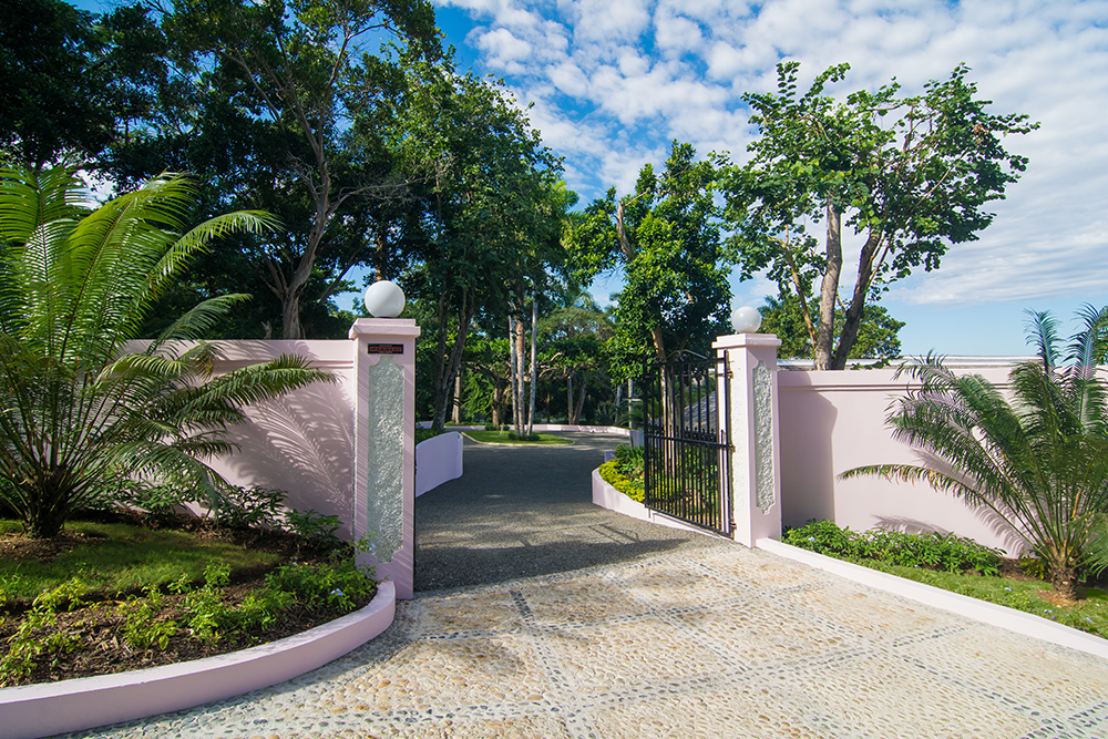 The entire property is fenced and entered through wrought iron gates, ensuring complete privacy  and a secure location within a private gated neighborhood of other upscale villas.