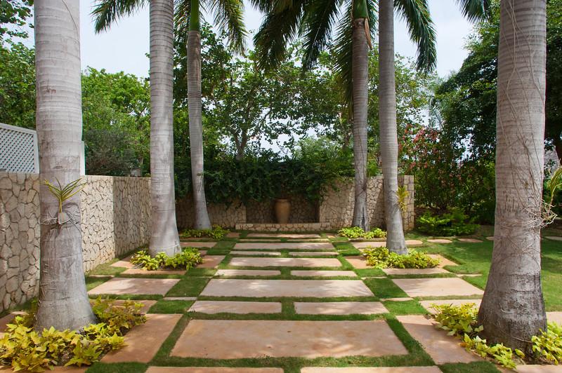 Stately Royal Palms adorn both properties.