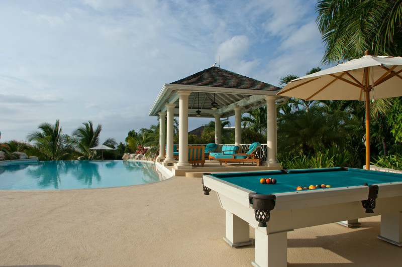 Pass the pool and pool table, take the paved path behind the gazebo ...