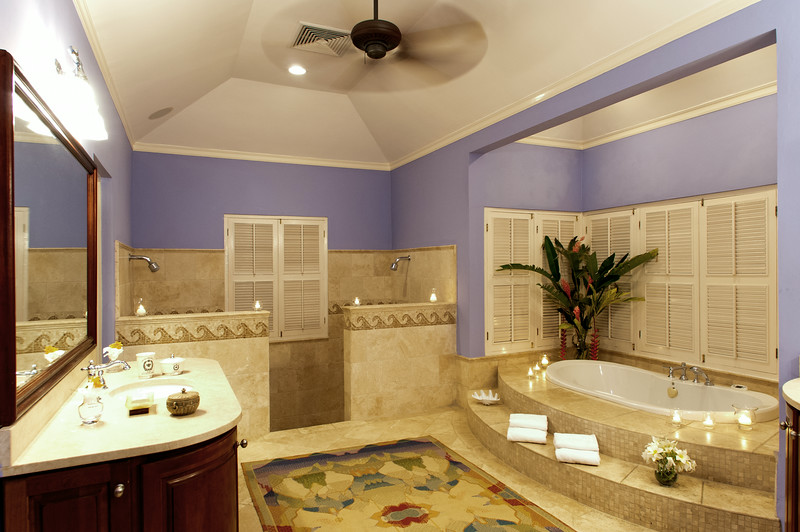 The Master Bath has his 'n' hers vanities, a spacious double shower and deep bathtub.  Louvered shutters can be closed for privacy or opened to the tropical view.