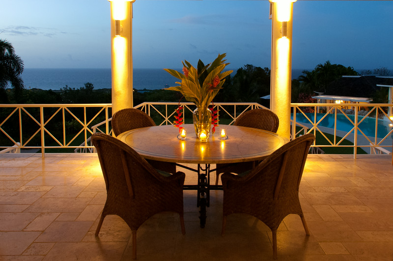 ... or more often for groups large and small, on the verandah with views of the grounds and sea.