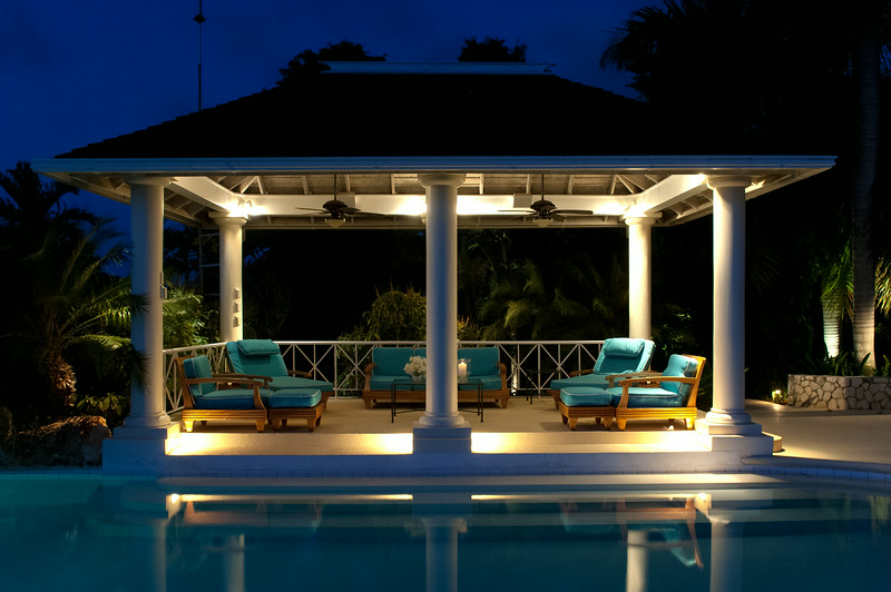 From the  gazebo and pool, watch memorable sunsets for which this home was named.