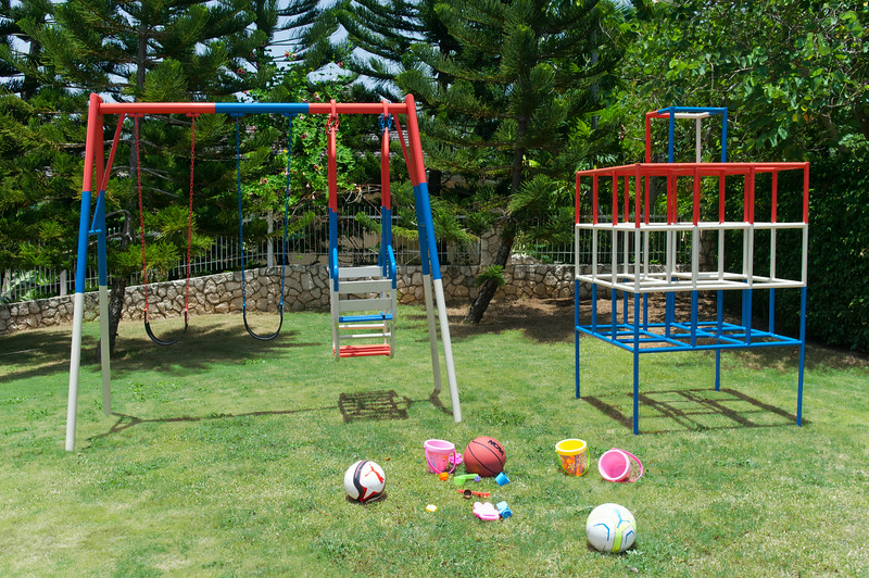 ... where a gate opens to the villa's playground with swings, climbing bars and ...