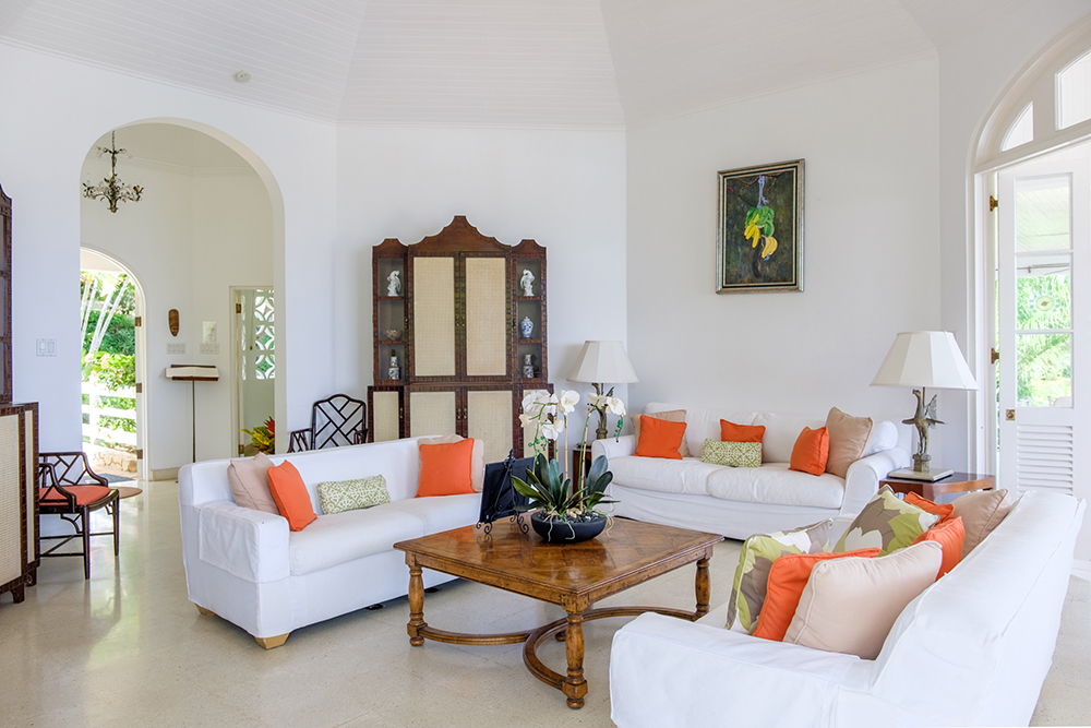 Bright & airy sitting room with three sets of french doors