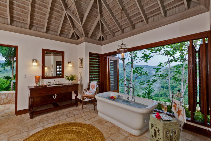 The 400-sq-ft bathroom has his 'n' hers dressing tables and a large open shower.  The deep soaking bathtub is walled by louvers that can remain closed or open wide to the glorious virgin moun