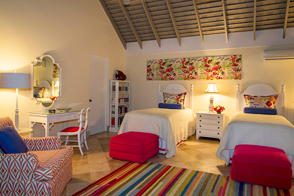 Bedroom 3 – Red Room (teens' favorite) Large room with optional kingsize, 2 twin beds ... spacious enough for an additional twin bed, cot or crib.  French doors open to the central courtyard