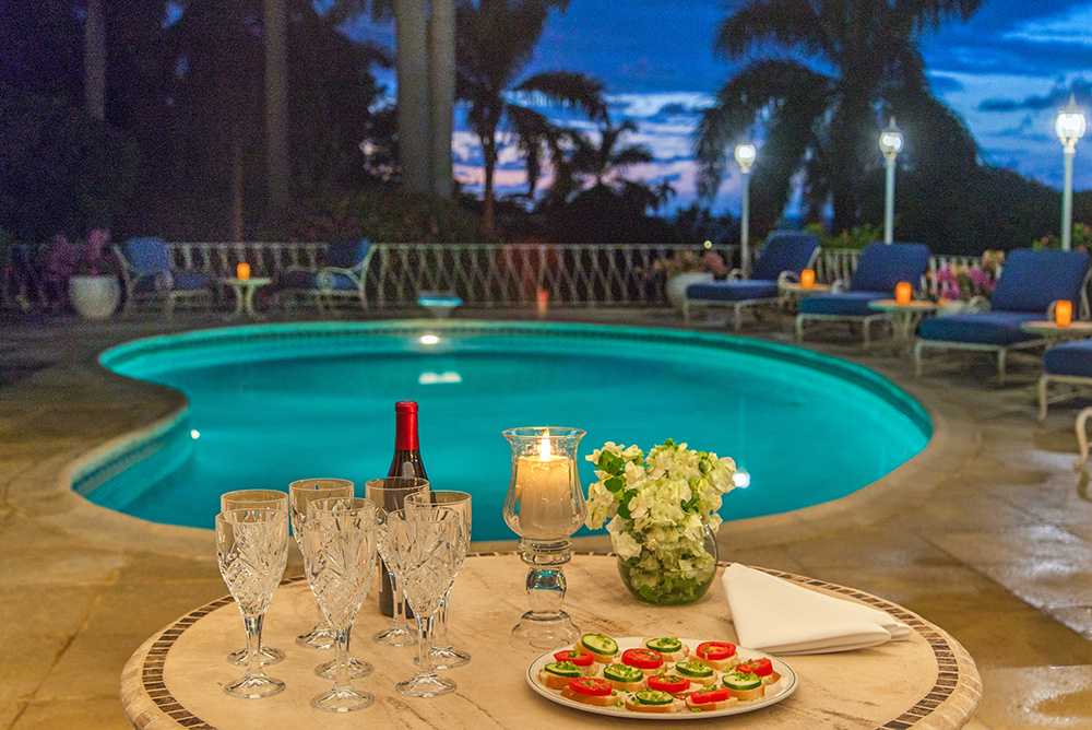 Ask your chef to feed the kids early.  Then, enjoy your own memorable evening starting with hors d'oeuvres by the pool ...