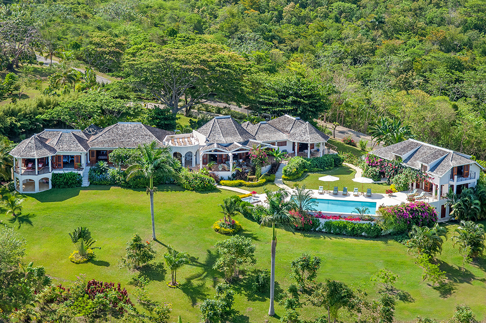 SUGAR HILL is a luxurious eight-bedroom villa perched atop a lush three-acre property with magnificent views of the Caribbean Sea.