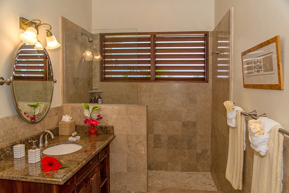 Handsome en-suite bathrooms repeat consistent quality throughout the Main Villa and the Guest Cottage.