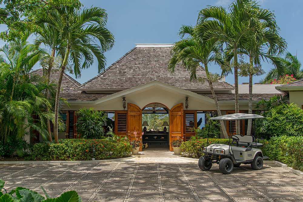 Enter the Main Villa through palm-fringed double doors.