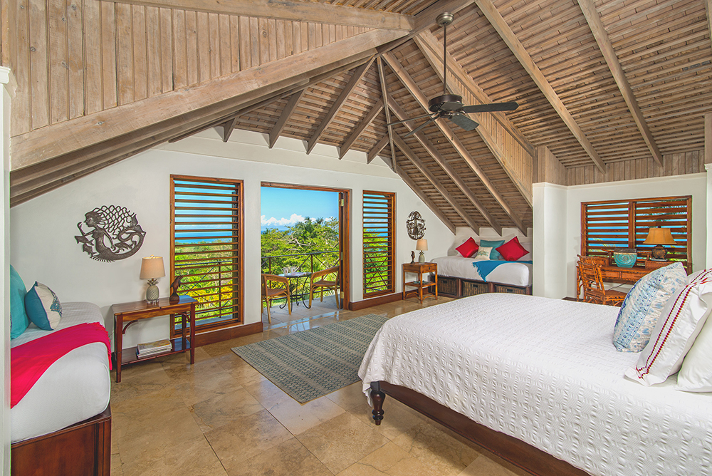 The fourth bedroom upstairs is a very private large suite. A hideaway on high with a wide balcony facing the sea, the distant horizon and unforgettable sunsets.