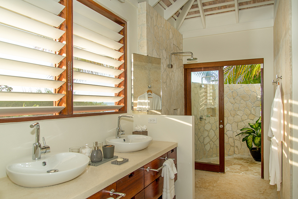 Upgraded bathroom with outdoor shower.