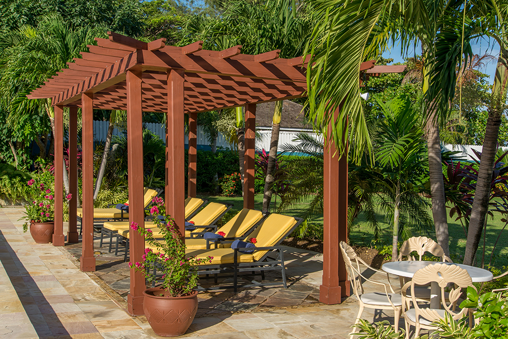 The large lawn is trimmed in colorful plants, and the 20' x 40' pool with plenty of sun loungers, and...