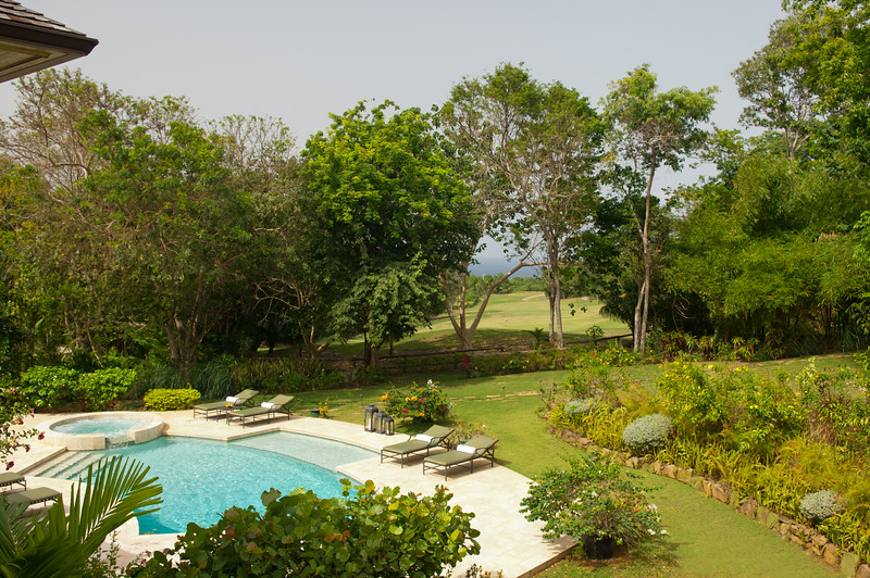 Its balcony overlooks the pool and long green view down the 12th fairway of the golf course, all the way to the sea.