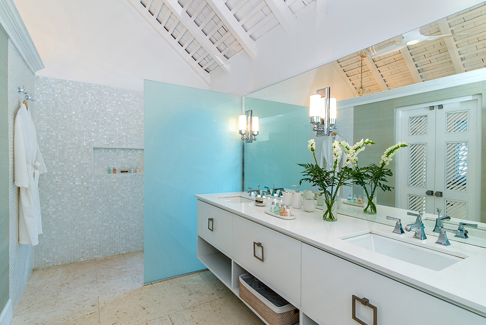 Bathrooms are air-conditioned and feature the ease of seamless-entry shower access.