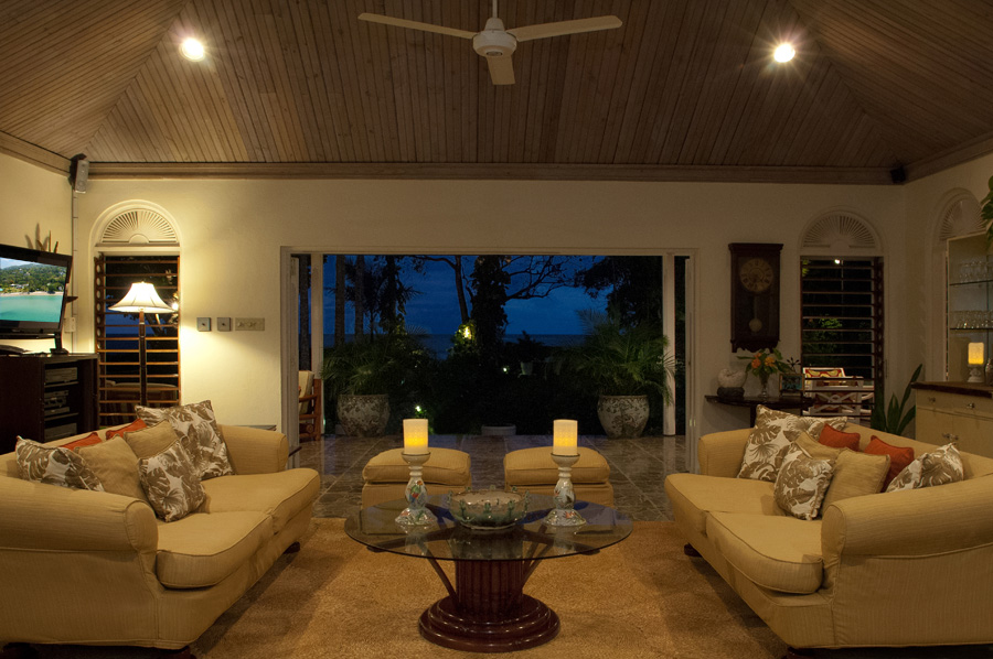 Inside the Main Villa, the Great Room opens wide to the furnished verandah ...