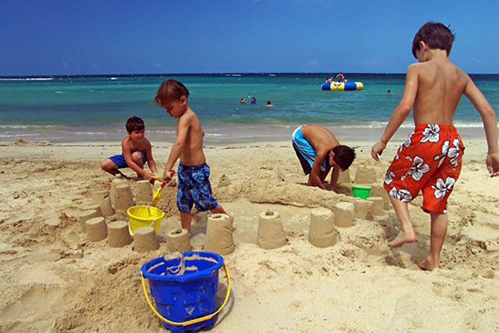 The soft sand is a magnet for parents and children alike.